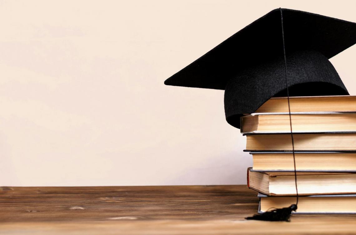 mortar board on books